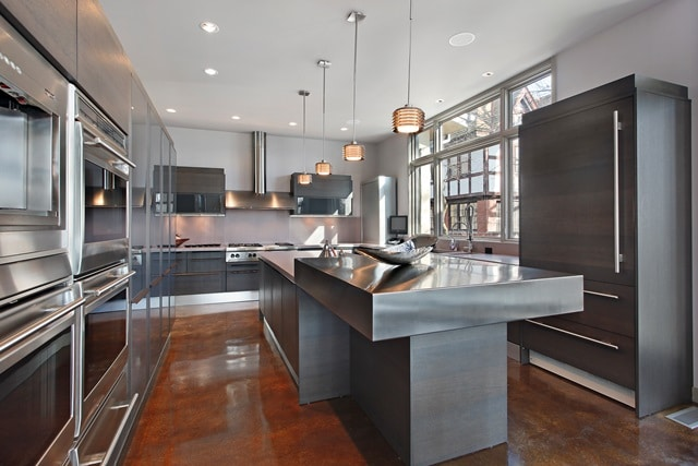High-end apartment kitchen with island and stainless steel appliances